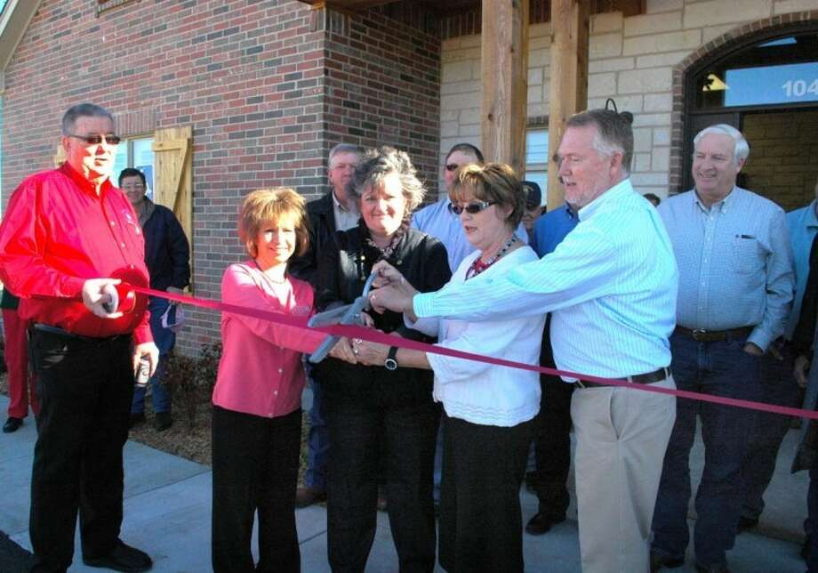 Gordon Zeigler/Plainview HeraldGreat Plains Ag Credit held a ribbon cutting Dec. 16 at its new location at 104 N. I-27. Pictured are: Plainview Chamber of Commerce Red Coat Emmett Tipton; Harriett Burleson, assistant vice president, lending; Daleyn Schwartz, administrative assistant; Tammy Fields, loan administrator; and Cliff Daniel, vice president/branch manager.