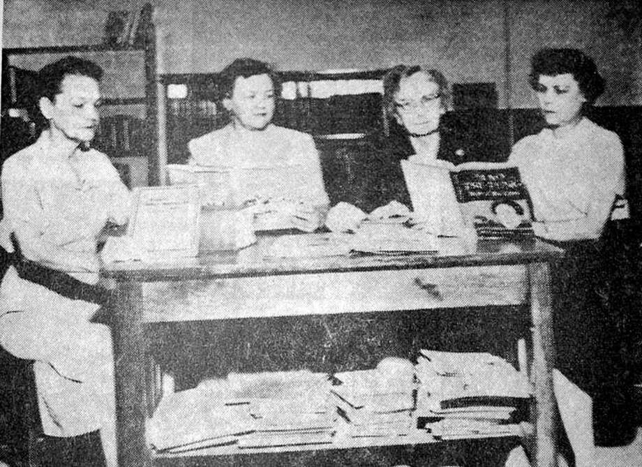 Herald File PhotoFour local women credited with boosting the Plainview Public Library in its 1952 expansion are Mrs. E. B. Tunnell (left), retiring library board president; Mrs. W.B. Davenport, member of the expansion committee; Mrs. M.W. Lemons, board president-elect; and Mrs. Bob Thomas, librarian. They are shown in the newly-added section of the library which increased floor space by a third.