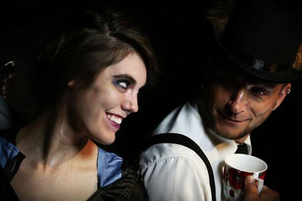 """Gina Hughes (from left) and John Lambert step into the roles of Alice and the March Hare, respectively, in the fourth season of """"Queen's Castle"""" at the Overtime Theater."""