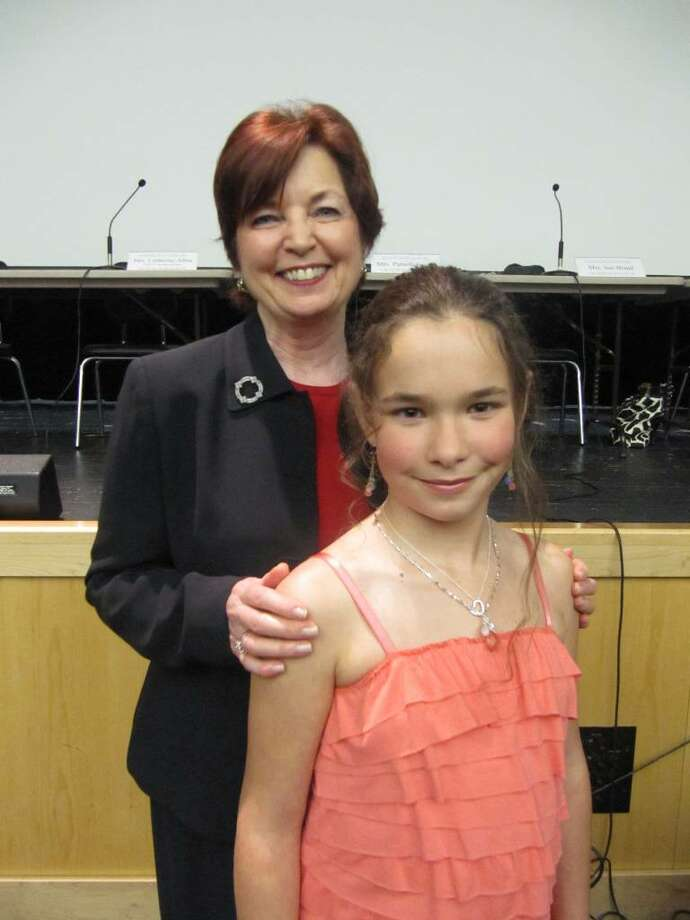 Superintendent of Schools Ann Clark congratulates Lily Didomenico of Roger Sherman Elementary School. Photo: Kirk Lang / Fairfield Citizen
