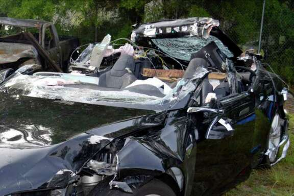 The National Transportation Safety Board said in a preliminary report that this Tesla Model S was traveling at 74 mph in a 65-mph zone on a divided highway near Gainesville just before hitting the side of a tractor-trailer.