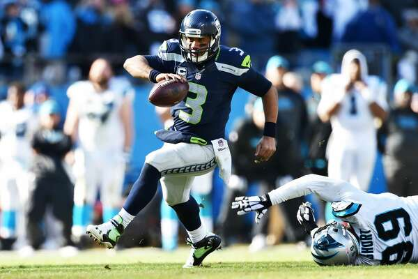 CHARLOTTE, NC - JANUARY 17:  Quarterback Russell Wilson #3 of the Seattle Seahawks scrambles during the NFC Divisional Playoff Game against the Carolina Panthers at Bank of America Stadium on January 17, 2016 in Charlotte, North Carolina.  (Photo by Ronald C. Modra/Sports Imagery/Getty Images)
