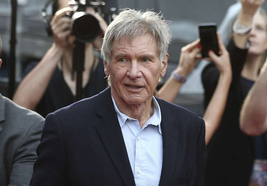 In this December 10, 2015 file photo, Harrison Ford greets fans during a Star Wars fan event in Sydney. Photo: Rob Griffith, Associated Press