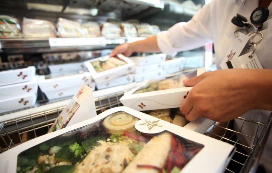 An employee stocks salads at a Pret A Manger restaurant in London on June 29, 2011. Photo: Chris Ratcliffe/Bloomberg