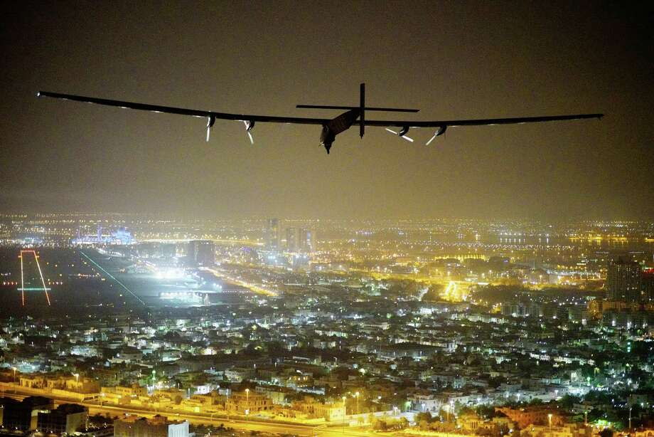 Solar Impulse 2, the solar-powered plane piloted by Swiss pioneer Bertrand Piccard, gets ready to land Tuesday in Abu Dhabi to finish the first around the world flight without the use of fuel. Photo: Solar Impulse 2 / 2016 SI2  Jean Revillard