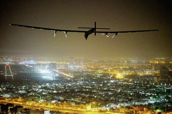 Solar Impulse 2, the solar-powered plane piloted by Swiss pioneer Bertrand Piccard, gets ready to land Tuesday in Abu Dhabi to finish the first around the world flight without the use of fuel.