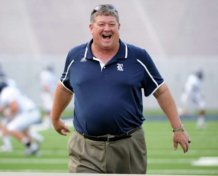 Rice head coach David Bailiff walks on the field before Rice's spring football game on April 11, 2014, at Rice Stadium in Houston.