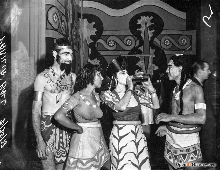 Parilia Ball Feb 25, 1938, Aztec costumes drinking alcohol. Courtesy of OpenSFHistory.org. Photo: Courtesy Of OpenSFHistory.org