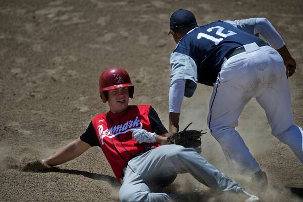 Team USA's Martin Valencia tags out Team Denmark's Andreas Adelsbaek as he slides into third base slides in the fourth inning of the game on Tuesday afternoon during the 2016 International Softball Federation (ISF) Junior MenÕs World Championship at Currie Stadium.