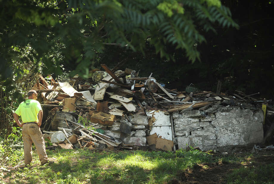 A house cited by the city for blight at 147 Jewett Street in Ansonia, Conn. is demolished to a pile of rubble on Tuesday, July 26, 2016. Photo: Brian A. Pounds, Hearst Connecticut Media / Connecticut Post