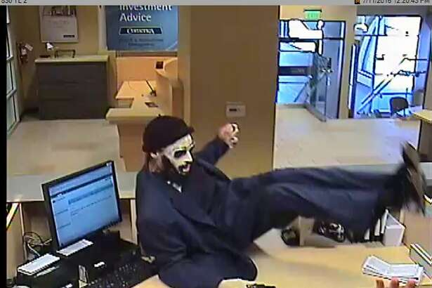 "The ""Dreaded Bandit"" is seen on a security camera jumping the counter of a Bay Area bank."