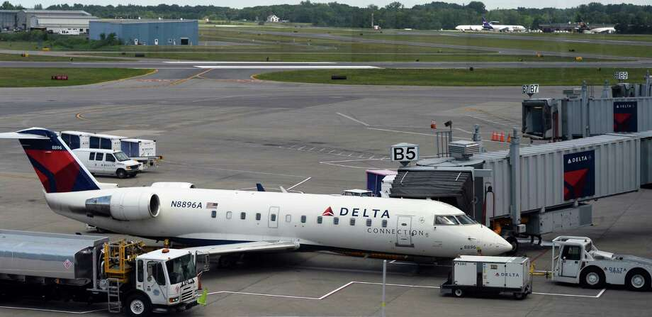 A Delta jet at their terminal at Albany International Airport Tuesday July 26, 2016 in Colonie, NY.  (John Carl D'Annibale / Times Union) Photo: John Carl D'Annibale / 20037447A