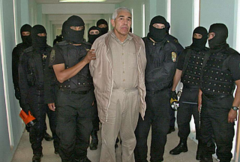 "File picture of former top Mexican drug cartel boss, Rafael Caro Quintero, under custody at the ""Puente Grande"" prison in Guadalajara on January 29, 2005.  Caro Quintero, who masterminded the kidnap and murder of a US anti-drug agent, has been ordered released in Mexico on August 9, 2013. A criminal court in the western state of Jalisco ordered Rafael Caro Quintero's release on August 7, 2013, a court official told AFP. Caro Quintero had served 28 years in prison for the 1985 murder of US Drug Enforcement Administration special agent Enrique Camarena, who was kidnapped in Guadalajara and tortured and murdered. As of June, Caro Quintero was still wanted in California on charges related to the murder and to drug trafficking.     AFP PHOTO/PFPHO/AFP/Getty Images Photo: HO, AFP/Getty Images"