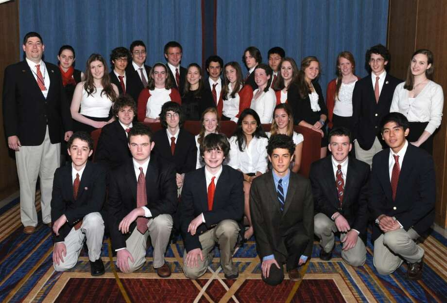"Greenwich High School students won a special ""Unit Award"" for showing expertise on the topic ""How The Framers Created The Constitution"" at the 2010 ""We The People: The Citizen and the Constitution National Competition,"" held last weekend in Washington, D. C. Unit Awards are given to teams of high school students that don't rank in the top 10 during the annual competition, but show expertise in a particular area. Pictured are members of the 2010 team with their coach, social studies teacher Aaron Hull. The students are, from left, front row, kneeling, Charlie Plissner, Sam Dealy, Zach Lederman, Jacob Fass, John Cofer and Joseph Ting; second row, seated, Daniel Keller, Greg Edelston, Kendall Witmer, Mariana Frias and Barbara Callahan; third row, Allison Misciagno-Bergin, Mary Bacon, Assistant Coach Lauren Siket, Caela Murphy, Jordana Cepelewicz, Mallory Muratore, Tess Vorselen, Caroline Glover, Tomas Agrest and Caroline McLennan; and back row, Maddie Abbott, Arman Rye, Matthew Mankins, Francis Ambrogio, Brian King, Tyler Chapin and Hyun Woong Chang. The national competition pits hundreds of students from 50 states as well as the Northern Mariana Islands, a commonwealth that is politically aligned with the United States, against one another to demonstrate their knowledge of constitution principles. Last year the GHS team earned an honorable mention and a top-10 ranking in the competition. Photo: Contributed Photo / Greenwich Time Contributed"