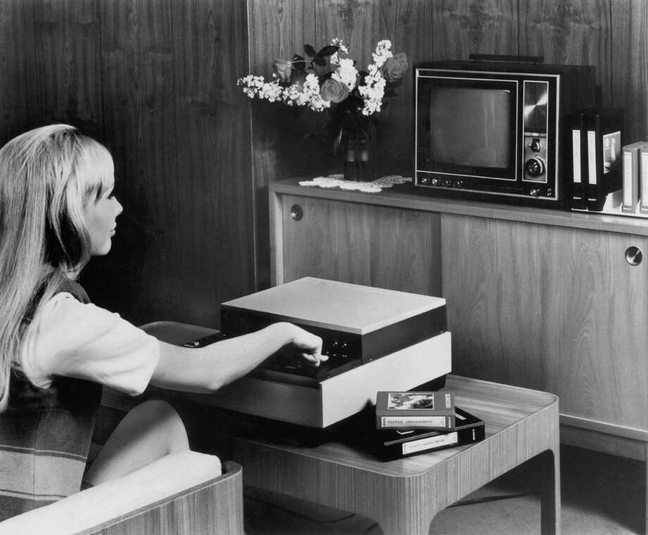 A woman demonstrates the Sony Videocasette player in 1970. Japan's Funai Corp., thought to be the last active manufacturer of VCRs, said it would cease production at the end of July — a death rattle for a technology that once was ubiquitous in American homes. Photo: Courtesy Photo / HANDOUT