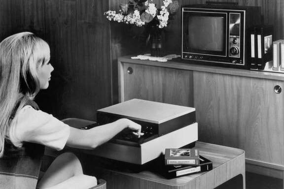 A woman demonstrates the Sony Videocasette player in 1970. Japan's Funai Corp., thought to be the last active manufacturer of VCRs, said it would cease production at the end of July — a death rattle for a technology that once was ubiquitous in American homes.