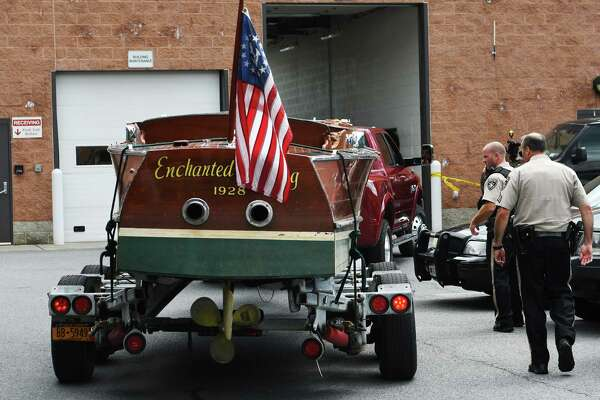 The boat that was struck by another boat on Lake George last night is brought to the Warren County Sheriff's office on Tuesday, July 26, 2016, in Queensbury, N.Y.   (Paul Buckowski / Times Union)