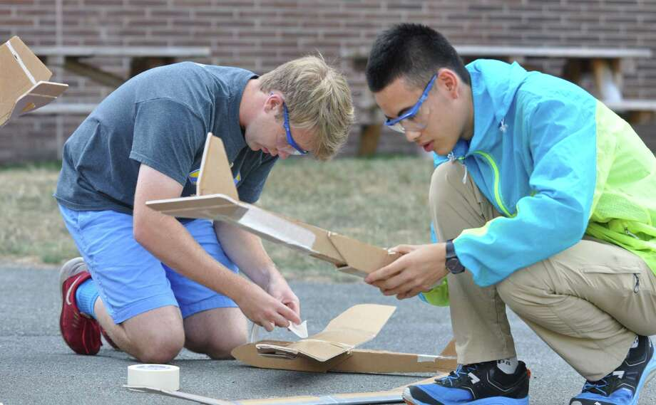 Ryan Purdy, 17, from Wilton, Conn., left, and Richard Liu, 17, from China, right, work on their model airplanes during the Aerospace Engineering Summer Program at Rensselaer Polytechnic Institute on Tuesday, July 26, 2016 in Troy, N.Y. The program is for students looking to explore a career in engineering, science, and/or physics. (Eliza Mineaux/Special to the Times Union) Photo: Eliza Mineaux / 20037216A