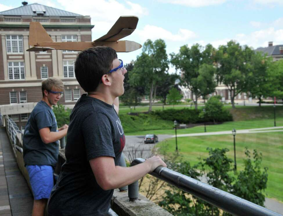 Cody Kohn, 16, from Morristown, N.J., right, tests out his model airplane during the Aerospace Engineering Summer Program at Rensselaer Polytechnic Institute on Tuesday, July 26, 2016 in Troy, N.Y. The program is for students looking to explore a career in engineering, science, and/or physics. (Eliza Mineaux/Special to the Times Union)