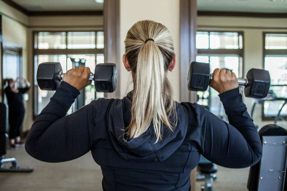 """The best gyms in HoustonAmanda Arlauskas, a former contestant on """"The Biggest Loser,"""" lifts weights in Raleigh, N.C., April 22, 2016.Keep going for a look at the top-rated places to get in shape in Houston. Photo: GEORGE ETHEREDGE, STR / NYTNS"""