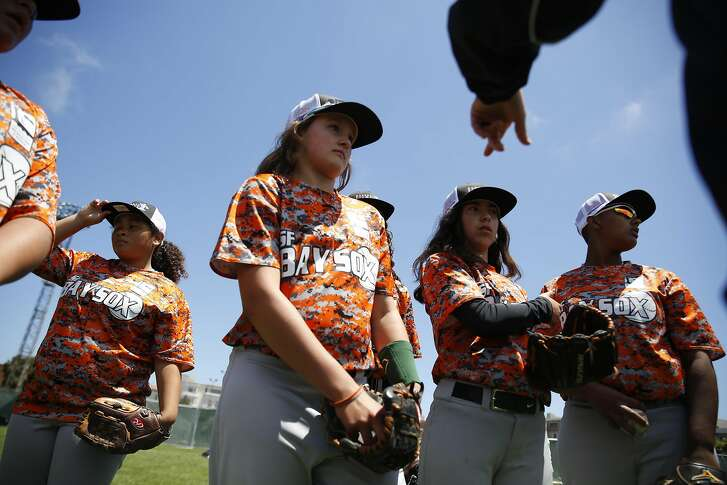 SF Bay Sox members listen to manager Alex Oglesby (hands at upper right) before the SF Bay Sox play the DC Force during the Baseball for All 2016 National Tournament at Moscone Recreation Center on Monday, July 25, 2016 in San Francisco, California.