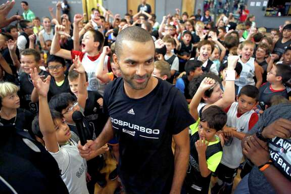 The Spurs' Tony Parker is surrounded Tuesday, July 26, 2016 by kids attending his basketball camp. Parker and his two brothers spent time at the camp Tuesday, playing a few games of 3-on-3 against camp attendees.