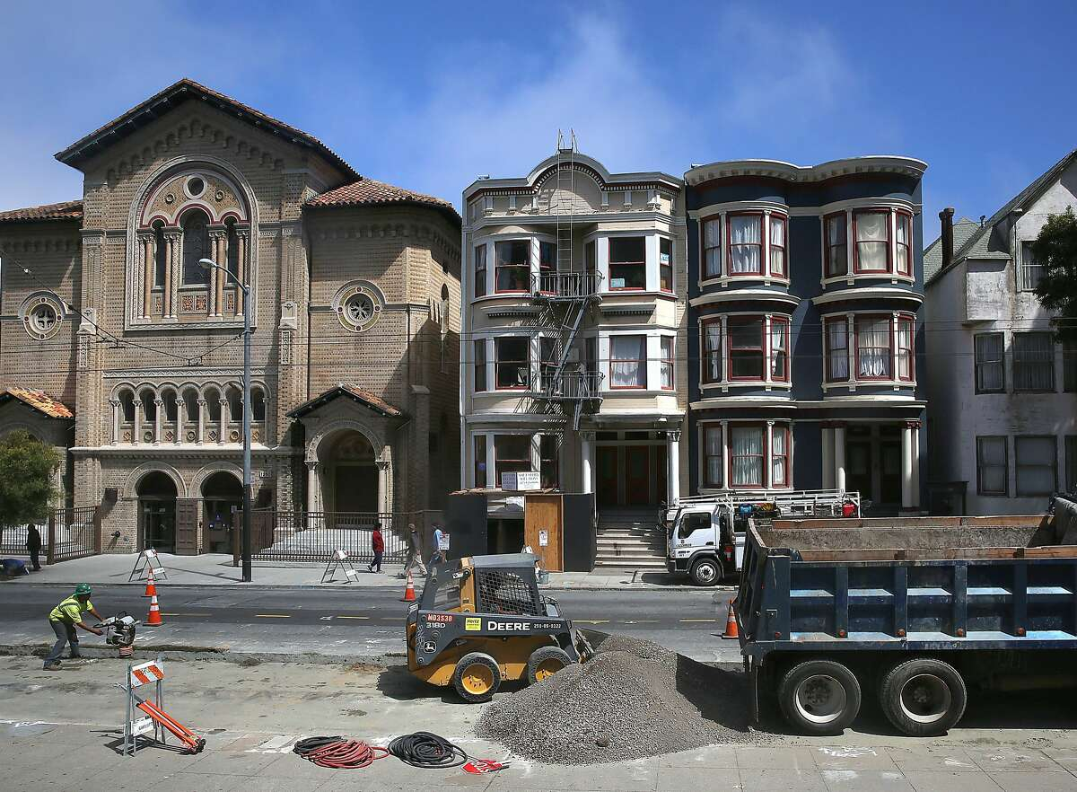 Contractor John Pollard talks about the soft story retrofit on this apartment building (middle) on 1230, 1232, and 1234 Haight St. on Monday, July 25, 2016, in San Francisco, Calif. San Francisco property owners have 60 days to file plans to retrofit wood-frame apartment buildings or may face fines.