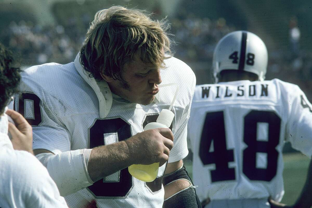 Center Jim Otto #60 of the Oakland Raiders drinks Gatorade on the sideline against the San Diego Chargers at San Diego Stadium on December 3, 1972 in San Diego, California. The Raiders defeated the Chargers 21-19.