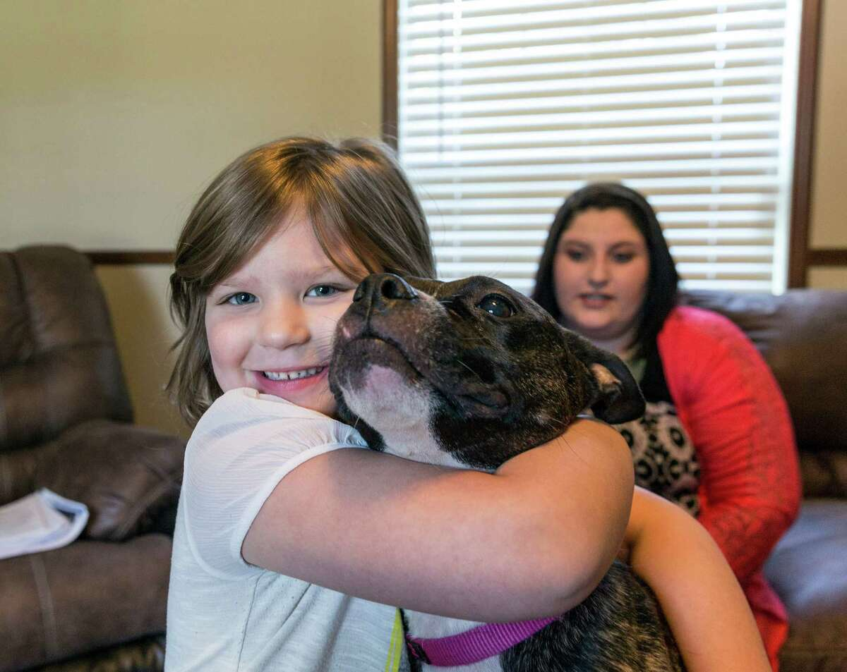 Maxie Foster, daughter Colbie and rescue dog Trix moved into a mobile home on her parents' property in Magnolia while she battles her former employer.