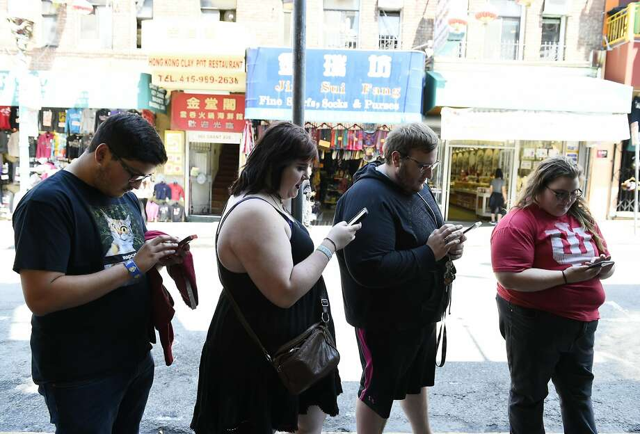 "Tyler Calcagno (left), Chastity Shilling, Dylan Davis and Sarah Ayers play ""Pokémon Go"" last month in San Francisco. Photo: Michael Noble Jr., The Chronicle"