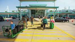 Passengers of the Norwegian Jewel disembark from the cruise ship at the Bayport Cruise Terminal on Saturday, Feb. 14, 2015, in Seabrook. ( Brett Coomer / Houston Chronicle )