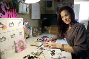 "Shannon Wallner, an avid pocket letter creator, happy mail sender and administrator of the Facebook group ""Chic Pocket Letters And Planner Lovers Swaps."" in her home studio."