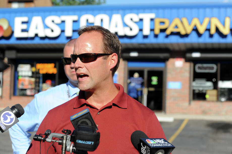 Bridgeport Police Captain Brian Fitzgerald speaks in front of East Coast Pawn, on Glenwood Ave. in Bridgeport, Conn. July 26, 2016. A stolen nuclear density gauge was recovered at the pawn shop Tuesday afternoon. Photo: Ned Gerard, Hearst Connecticut Media / Connecticut Post