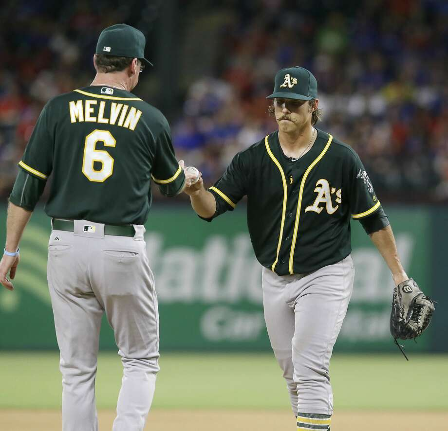 Oakland Athletics manager Bob Melvin (6) pulls starting pitcher Daniel Mengden during the fifth inning of a baseball game against the Texas Rangers in Arlington, Texas, Monday, July 25, 2016. The Rangers won 7-6. (AP Photo/LM Otero) Photo: LM Otero, Associated Press