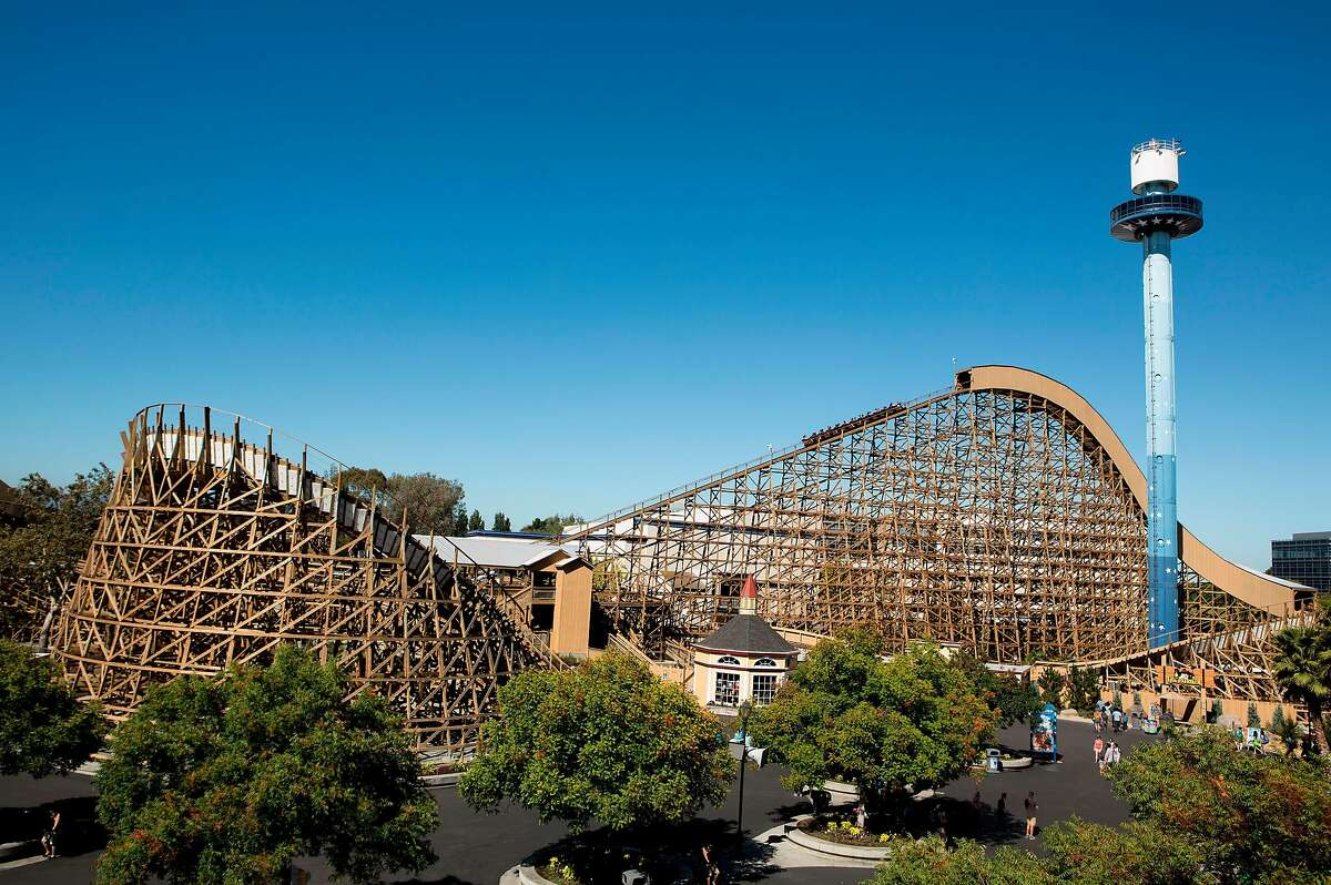 """The Gold Striker wooden roller coaster at California's Great America. A spokesman said Thursday that the theme park in Santa Clara will welcome out-of-state visitors """"with proof of full vaccination"""" when it reopens May 22."""