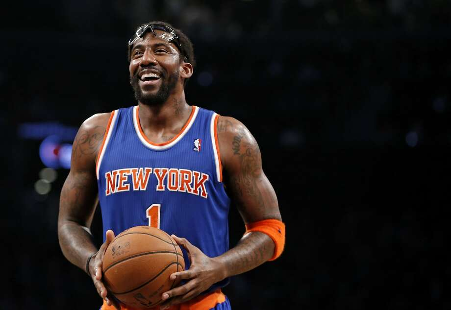 "FILE - In this Dec. 5, 2013, file photo, New York Knicks forward Amare Stoudemire smiles before shooting a free throw during the team's NBA basketball game against the Brooklyn Nets in New York. Stoudemire retired Tuesday, July 26, 2016, after signing a contract with the Knicks with much less fanfare than the $100 million deal he inked six years ago to halt the team's downward spiral. ""Although my career has taken me to other places around the country, my heart had always remained in the Big Apple,"" he said in a statement. ""Once a Knick, Always a Knick."" (AP Photo/Kathy Willens, File) Photo: Kathy Willens, Associated Press"