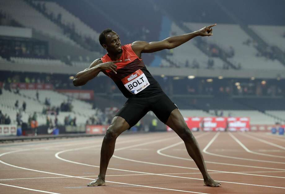Usain Bolt of Jamaica gives photographers his trademark pose at a recent meet. He has high expectations for Rio. Photo: Matt Dunham, Associated Press