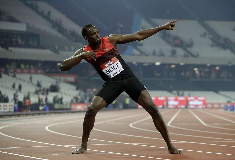 Usain Bolt of Jamaica gives photographers his trademark pose at a recent meet. He has high expectations for Rio. Photo: Matt Dunham, Associated Press