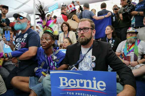 Supporters of Bernie Sanders stage a sit-in at a media tent after Hillary Clinton secured the delegates needed for the Democratic presidential nomination on the second day of the convention in Philadelphia.