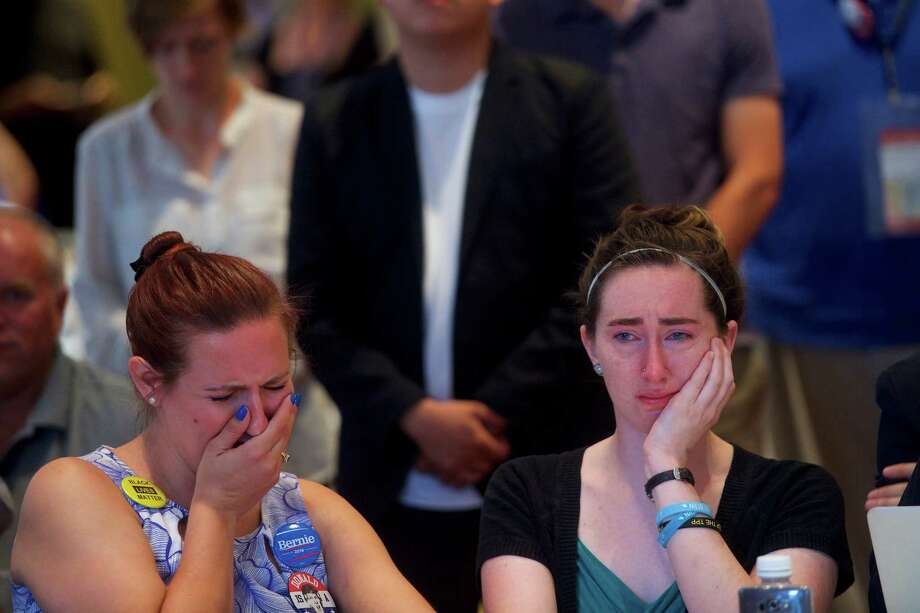 Jessica Fears, left, and Jesica Butler cry as Sen. Bernie Sanders addresses Iowa delegates during a morning event at the Marriott Downtown, on the second day of the Democratic National Convention in Philadelphia, July 26, 2016. (Mark Makela/The New York Times) Photo: MARK MAKELA, STR / NYT / NYTNS