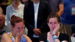 Jessica Fears, left, and Jesica Butler cry as Sen. Bernie Sanders addresses Iowa delegates during a morning event at the Marriott Downtown, on the second day of the Democratic National Convention in Philadelphia, July 26, 2016. (Mark Makela/The New York Times)