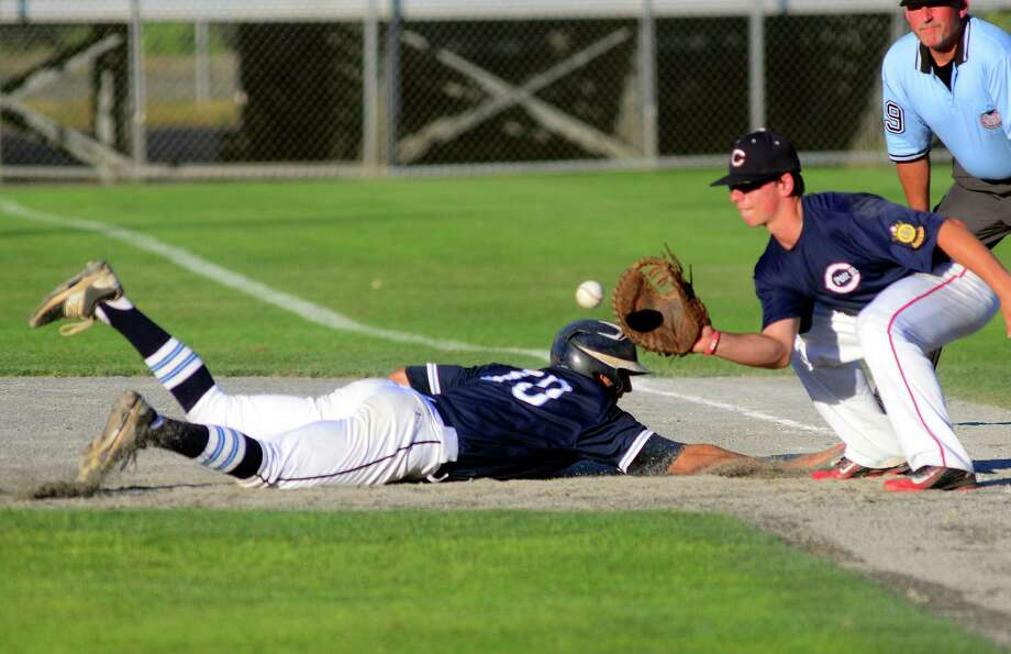 Stamford's Dean DePreta dives back to first to avoid being picked off by Cheshire's Nick Sansone during American Legion Super Regionals baseball action against Cheshire in Middleton, Conn., on Tuesday July 26, 2016. Photo: Christian Abraham / Hearst Connecticut Media / Connecticut Post