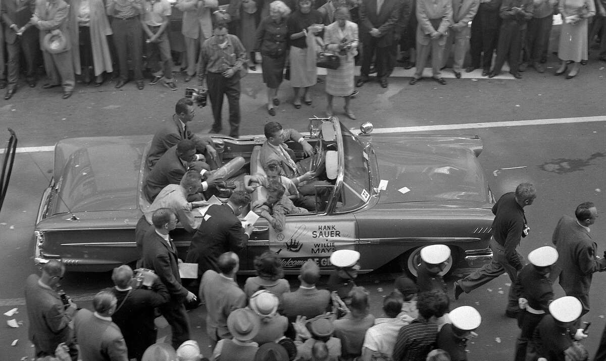 On April 14, 1958, Willie Mays and Hank Sauer share a float on Market Street during the San Francisco Giants welcome parade.