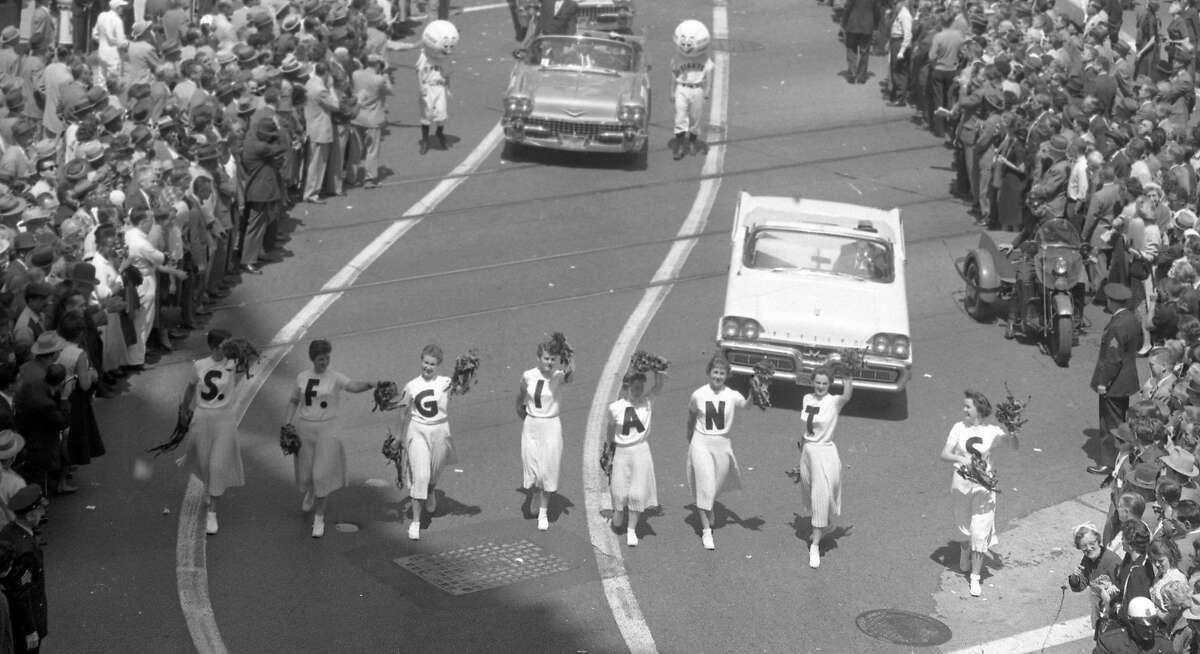 April 14, 1958: Cheerleaders walk down Market Street during the San Francisco Giants welcome parade.