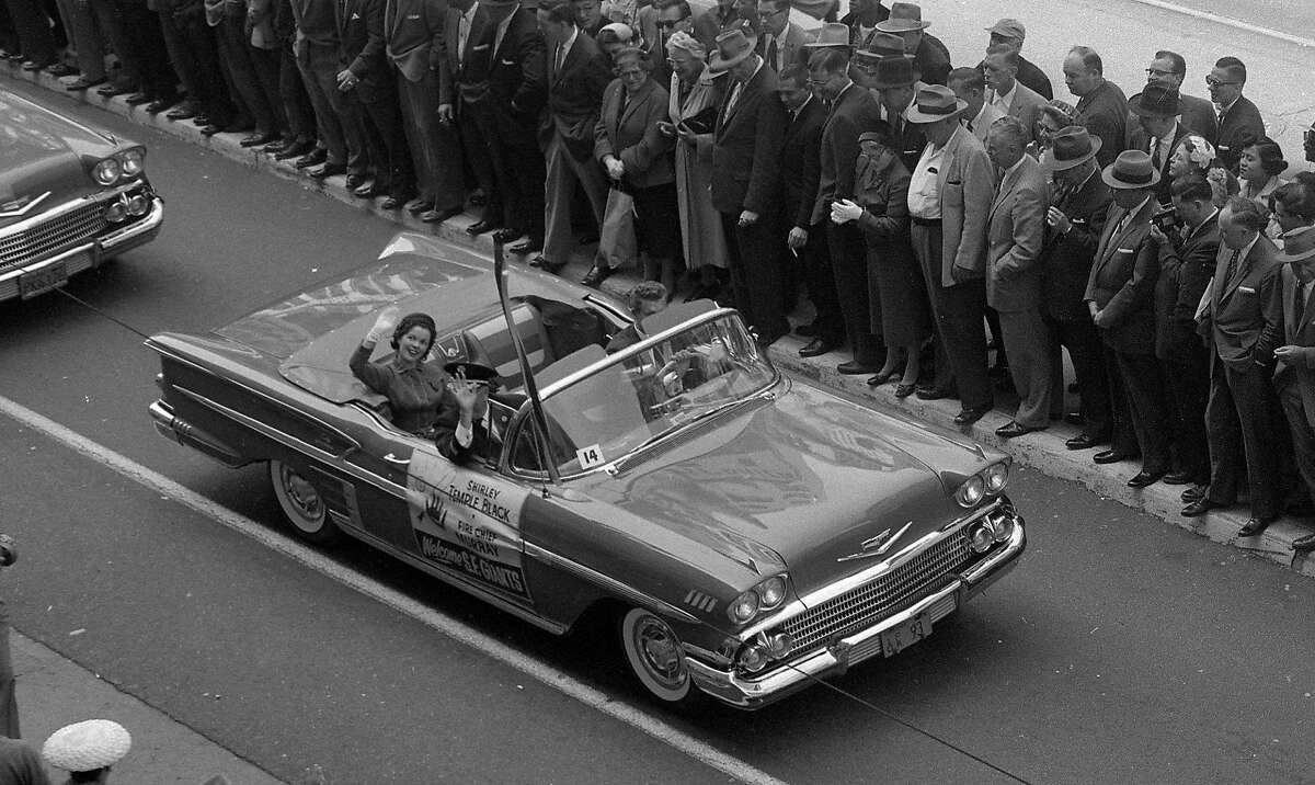 On April 14, 1958, Shirley Temple Black waves from a float during the San Francisco Giants welcome parade.