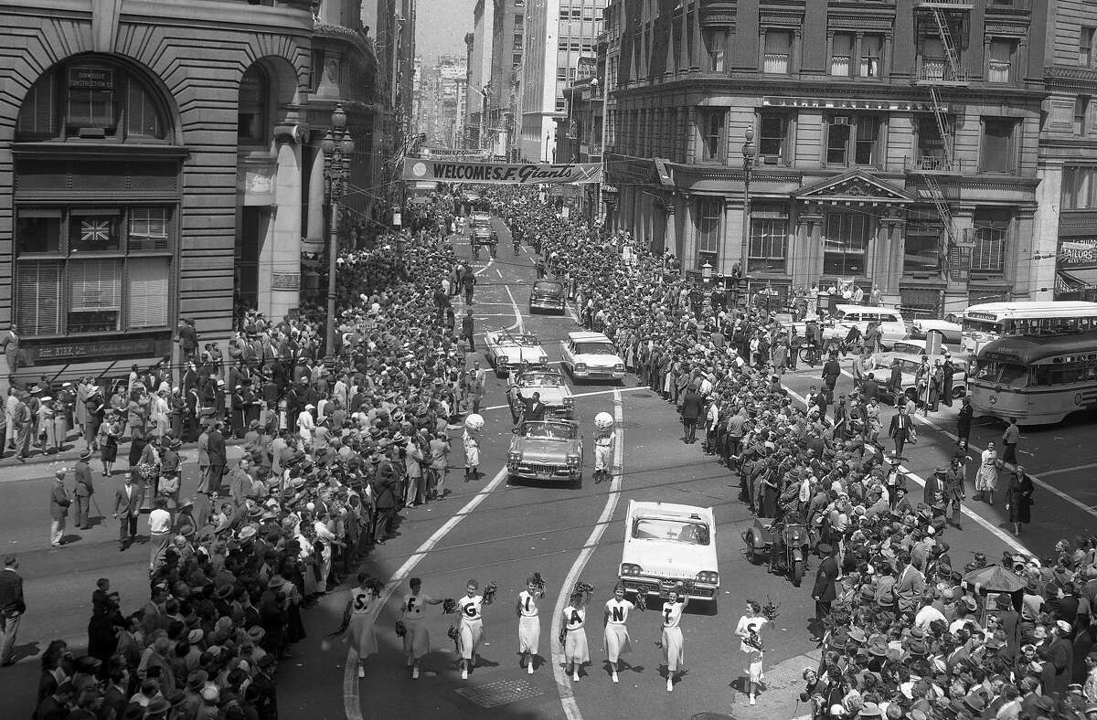 On April 14, 1958, cheerleaders walk down Market Street during the San Francisco Giants welcome parade.
