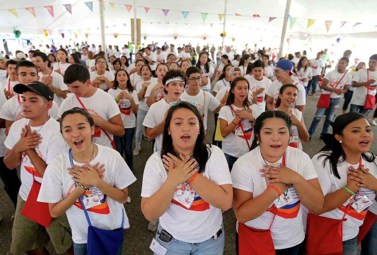 Youth sing during the World Youth Encounter Day part of the celebration of World Youth Day held at Saint Anne Catholic Church in the Pueblo de Palmas colonia in Penitas, Tx.