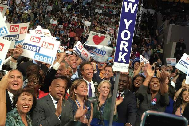 The scene on the Democratic convention floor as Gov. Andrew Cuomo announces New York state's vote to nominate Hillary Clinton in Philadelphia on Tuesday, July 26, 2016. (Casey Seiler/Times Union)