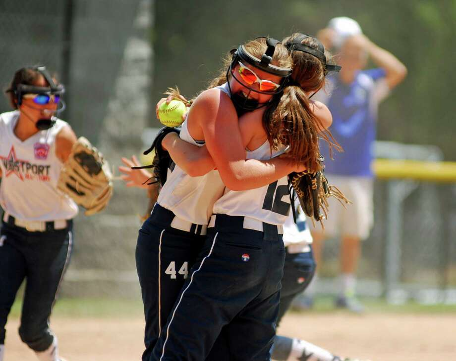 Westport's Morgan Carnahan celebrates with a teammate after winning the U10 Section 1 softball title. Photo: Ryan Lacey / Hearst Connecticut Media / Westport News Contributed