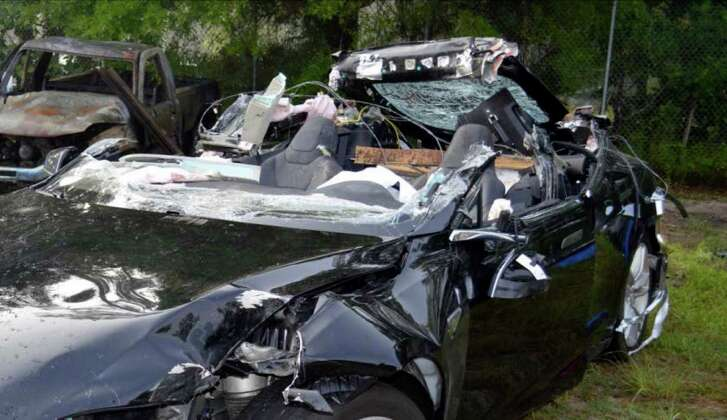 This photo is among those released by the U.S. National Transportation Safety Board showing the Model S that had its top sheared off when it hit a truck.